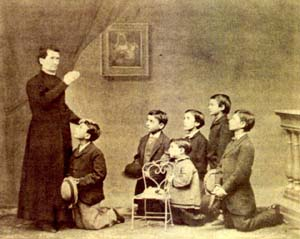 St. John Bosco blessing some young men