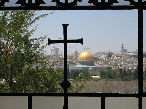 The window behind the altar looks out over Jerusalem