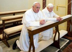 Benedict Francis kneeling