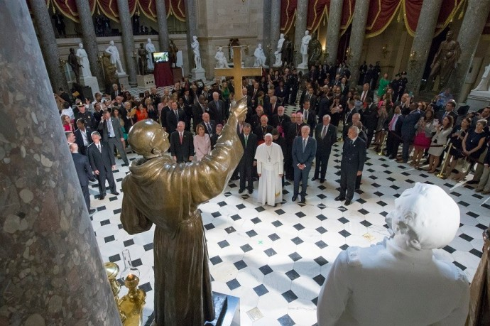 Pope Francis pauses in front of a sculpture of Spanish-born Franciscan Friar Junipero Serra in Statuary Hall at the U.S. Capitol in Washington DC